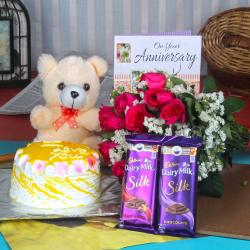 Anniversary Cake with Silk Chocolates and Teddy Hamper for Chandigarh