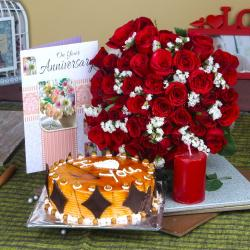 Anniversary Half Kg Butterscotch cake and Red Roses Bouquet with Candle for Dombivli