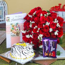 Anniversary Half kg Vanilla Cake and Fifty Red Roses with Chocolates for Dombivli