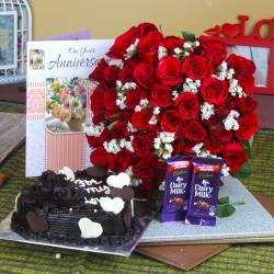 Anniversary Heart Shape Chocolate Cake and Fifty Roses Bunch with Chocolates for Moradabad
