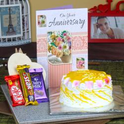 Anniversary Pineapple Cake with Assorted Chocolate and Greeting Card for Asansol