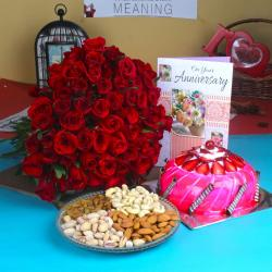 Anniversary Red Roses with Half Kg Strawberry Cake and Assorted Dry fruit for Moga