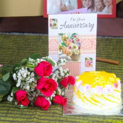 Anniversary Red Roses with Pineapple Cake and Wishes Card for Pune