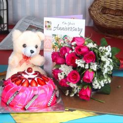 Anniversary Roses Bouquet with Strawberry Cake Combo Including Teddy and Greeting Card for Jaipur