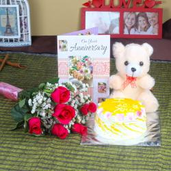 Anniversary Six Red Roses with Eggless Pineapple Cake and Teddy Bear for Jaipur