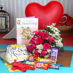 Anniversary Vanilla Cake along Red Roses Bouquet with Balloons and Assorted Chocolates
