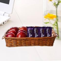 Apples in Basket along with Dairy Milk Chocolates for Moradabad