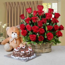 Arrangement of Red Roses and Half Kg Black Forest Cake and Teddy for Kolkata