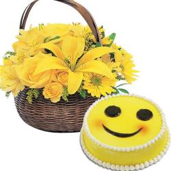 Arrangement of Yellow Flowers With Smilley Cake for Raichur
