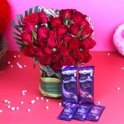 Assorted Cadbury Chocolate with Red Roses Arrangement for Shimla