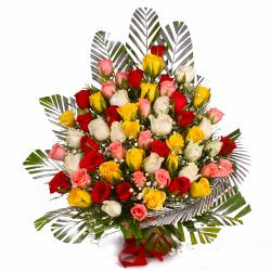 Basket Arrangement of 75 Multi Color Roses for Belgaum