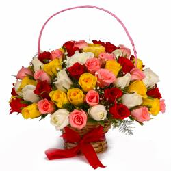 Basket Arrangement of Fifty Colorful Roses for Mumbai