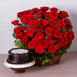 Basket Arrangement of Fifty Red Roses with Chocolate Cake for Bhopal