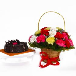 Basket of Colorful Carnations and Chocolate Cake Combo for Jaipur