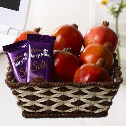 Basket of Pomegranates with Dairy Milk Silk Chocolates