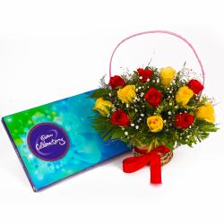 Basket of Twelve Red and Yellow Roses with Cadbury Celebration Chocolates for Ahmedabad