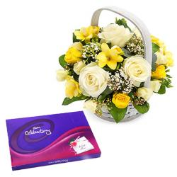 Beautiful basket of yellow and white roses with Celebration pack for Bharuch