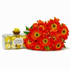 Bouquet of 10 orange Gerberas with 16 pcs Ferrero Rocher Chocolates for Coimbatore