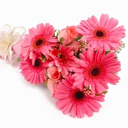 Bouquet of Pink Roses and Gerberas in Paper Wrapping for Mumbai
