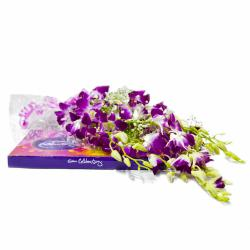 Bouquet of Six Purple Orchids with 118 Gms Celebration Chocolate Box for Madras