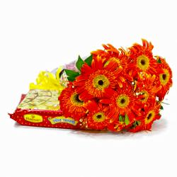 Bouquet of Ten Orange Gerberas with Soan Papdi for Kanchipuram