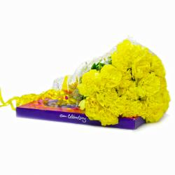 Bouquet of Twenty Yellow Carnations with Cadbury Celebration Chocolate Box for Delhi
