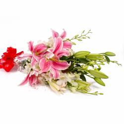 Bouquet of White Orchids and Pink Lilies with Cellophane Packing for Siliguri