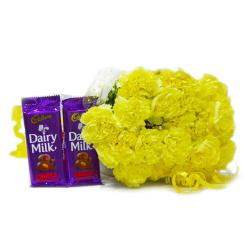 Bunch of 20 Yellow Carnations with Cadbury Fruit and Nut Chocolate Bars for Raipur