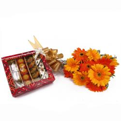 Bunch of Ten Colorful Gerberas and Assorted Sweets for Madras