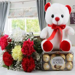 Colorful Carnations with Ferrero Rocher Chocolates and Teddy Bear for Bharuch