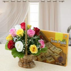 Combo of Soan Papdi Sweet with Colorful Roses Basket Arrangement for Lucknow