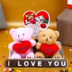 Couple Teddies Holding Heart with Home Made Chocolates and Love Card for Ghaziabad