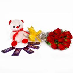 Cute Birthday Combo of Roses, Teddy and Chocolates for Ahmedabad