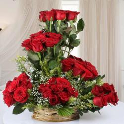 Designer Arrangement of Fifty Red Roses in Basket for Chandigarh