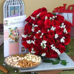 Dry Fruit and Fifty Red Rose Hand Bunch with Anniversary Greeting Card for Dewas