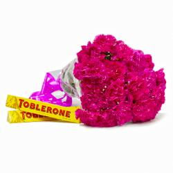 Elegant Bouquet of Pink Carnations with Toblerone Chocolate Bars for Gandhinagar