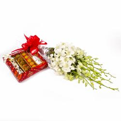 Exotic Orchids Bouquet and Assorted Indian Sweet Box for Belgaum