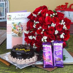 Fifty Red Roses Bouquet and Anniversary Cake with Chocolates for Noida