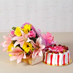 Fresh Cream Strawberry Cake with Bouquet of Exotic Flowers for Siliguri