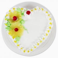 Fresh Pineapple Heart shape Cake for Baroda