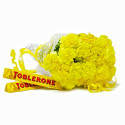 Hand Tied Bunch 20 Yellow Carnations with Toblerone Chocolate Bars for Gandhinagar