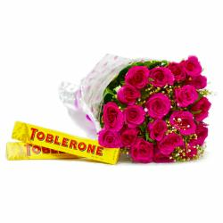 Hand Tied Bunch of 20 Pink Roses with Toblerone Chocolate Bars for Raipur