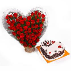 Heart shape Black Forest Cake and arranged of Red Roses for Lucknow