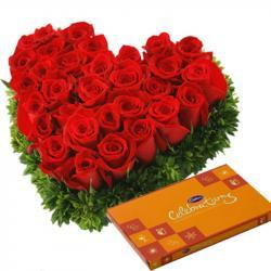 Heart Shape Roses Arrangement with Cadbury Celebration Chocolate for Manipal