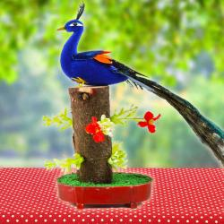 Home Decor Showpiece of Peacock on a Tree Trunk for Bangalore