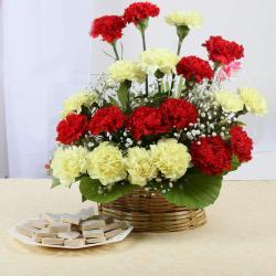 Kaju Katli Sweets with Carnation Arrangement for Moga