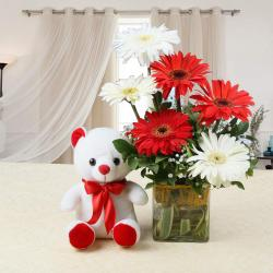 Lovely Teddy Bear with Gerberas in Vase for Gurgaon