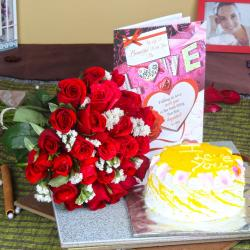 Pineapple Cake with Love Greeting Card and Red Roses Bouquet for Bangalore