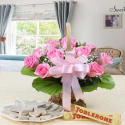 Pink Roses Arrangement with Kaju Katli and Toblerone Chocolates for Moga
