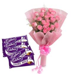 Pink Roses with Tissue Wrapping and Cadbury Dairy Milk Chocolate Bars for Ahmedabad